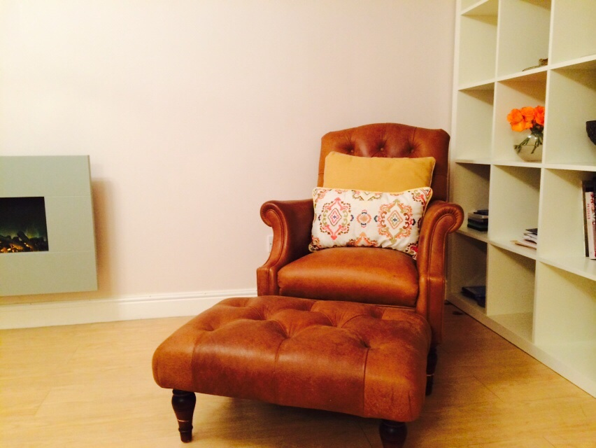 Reading corner leather buttoned chair with footstool