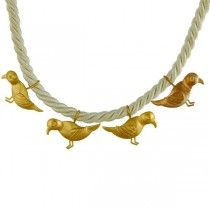 Birds in gold around your neck?