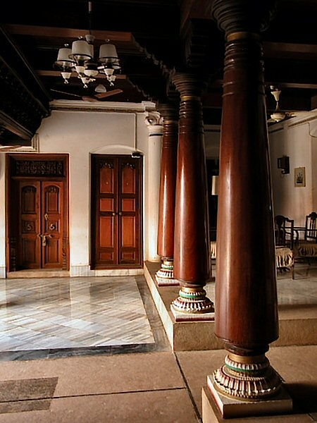 Another stunning 'chettinad' pillar with a glimpse of a door via