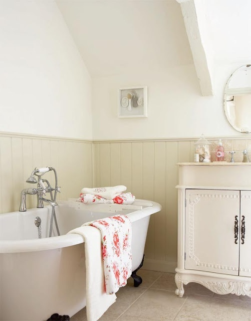 What a lovely cream bathroom...the bath tub, the cupboard...via