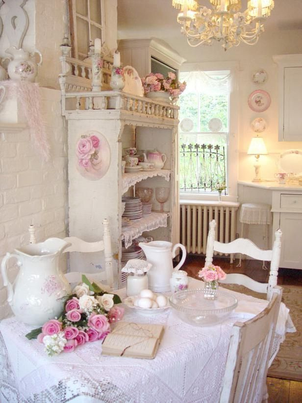 A cosy dining area...pink roses, a dresser, a lace table cover...all a 'must have'...for a typical British dining-kitchen via