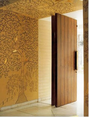 Mithila art...creating a masterpiece, all the way to the ceiling...via