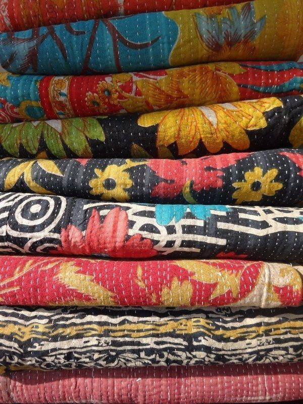 Stacks and stacks of handmade 'Kantha' quilts via