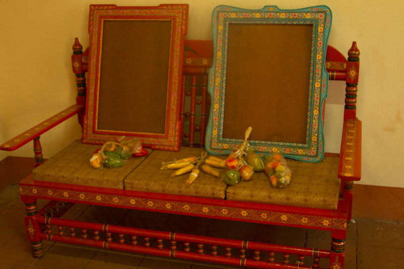 Old wooden sofa and frames painted in ganjifa style via