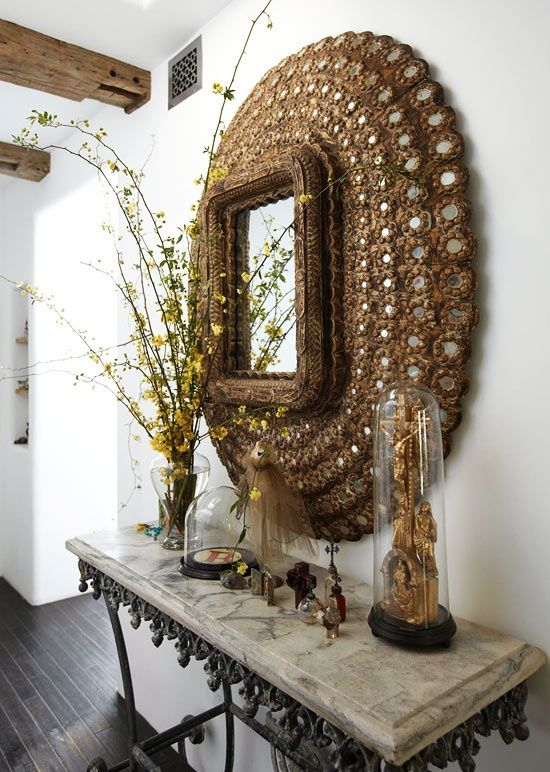 Peacock mirror with a french style table via